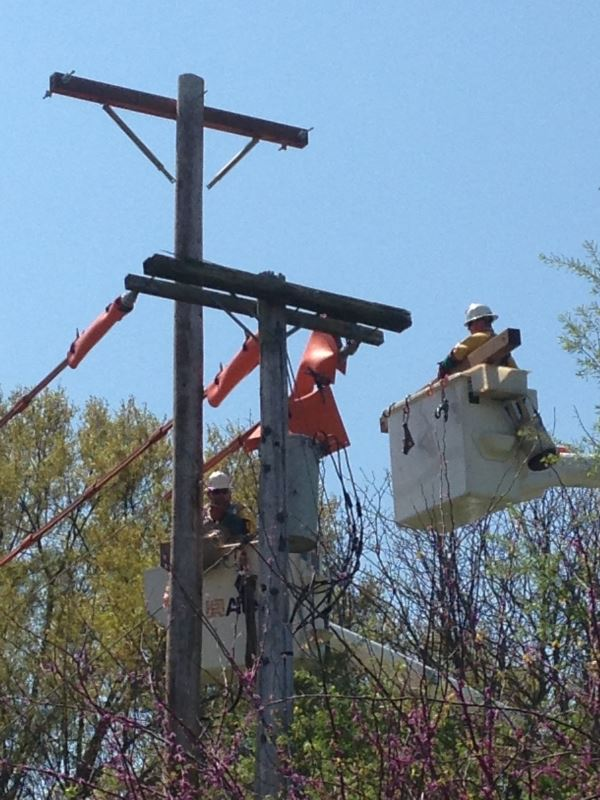 Electrical Division Workers Servicing a Utility Pole